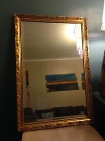 Heavy gold mirror