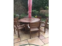 Outdoor garden round table and 6 chairs, solid wood. Selling do to new set arriving