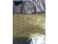 Petunia pickle bottom. Green/yellow with tan baby changing bag.