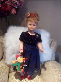 Doll in dark blue dress