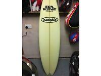 As new surfboard and boardbag