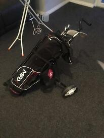 Golf clubs and trolly for sale