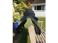 Black leather Paul Jones saddle, used once or twice, good condition.