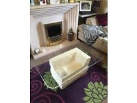 Bevel edge glass top coffee table and matching side table with simulated stone base.