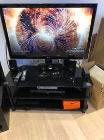 Floating black glass tv stand