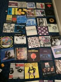 "150 singles, 7""vinyl 80's and 90s mainly"