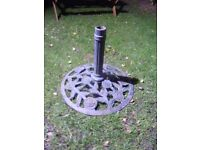 Large heavy decorative cast iron parasol stand.