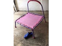 Children's mini trampoline with handle bar on one side