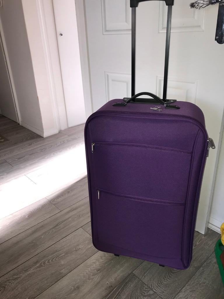 Brand new purple large suitcase