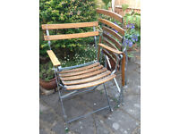 Two outdoor/indoor folding armchairs