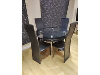 Chrome & Glass round table & faux black leather chairs