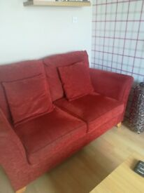 Two 2 seater sofas and a matching foot stool