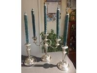 Silver plate Candelabra and Candlesticks with candles.