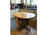 Fold out wooden dining table with 4 chairs