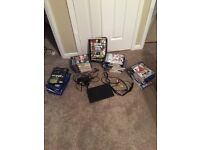 Slim Playstation 2 with power lead, TV attachment and 40 different games