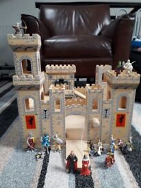 Wooden castle and figures about 14 of them . Good condition £30 . Pick up only