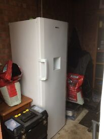 Beko tall Larder Fridge with stored water container.