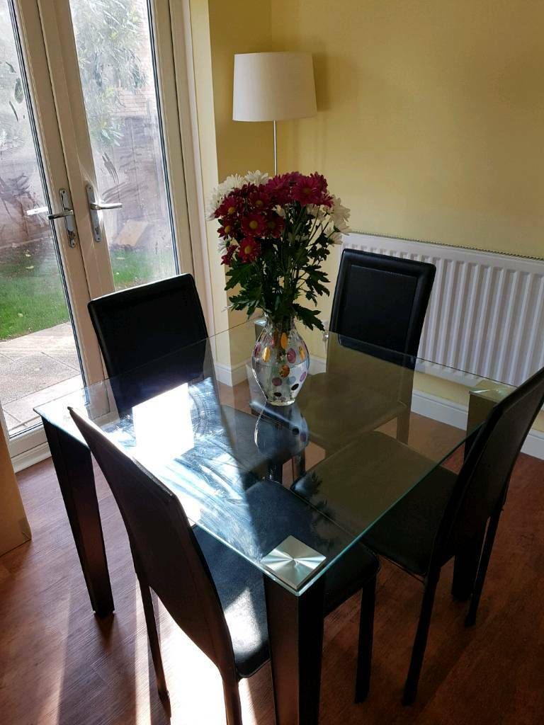 Dining table with 4 chairs in Milton Keynes, excellent conditionin Bradwell Common, BuckinghamshireGumtree - Available from 27/05/2017, excellent condition.Sleek and modern dining set. The compact, square table would work very nicely in a kitchen or small dining room. The table top is glass and the legs and chairs are upholstered in stylish faux leather....