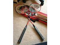 Two brand new very good badminton rackets with 4 shuttlecocks