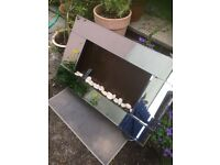 Electric mirrored wal mounted fireplace