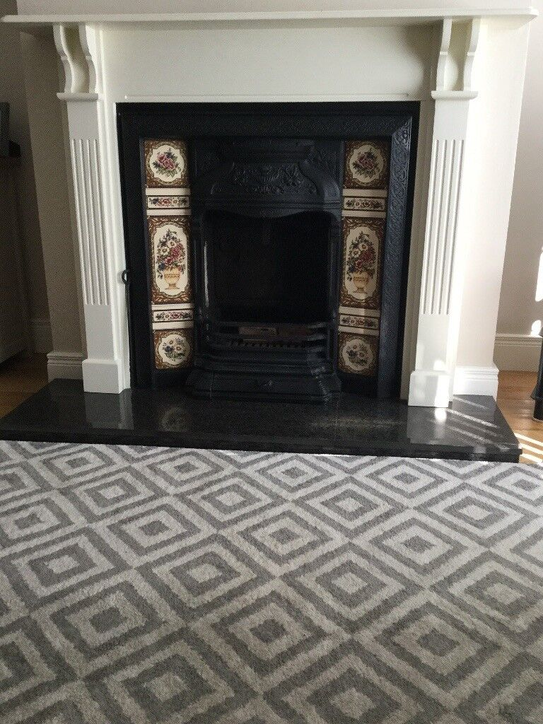 cast iron fireplace with tiled insert includes surround and 18in