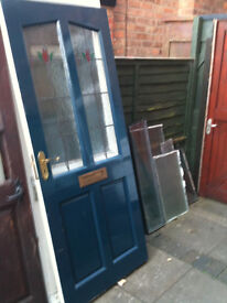Exterior hardwood door with frosted leaded glass panels