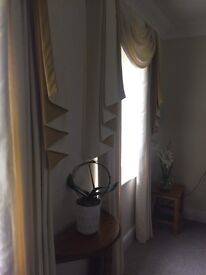 Heavy cream curtains with interface and coordinating swags with contrasting colour in ochre