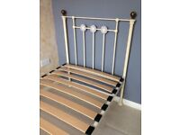 Single Metal bedframe in an off white colour, with a sprung slatted matress base.