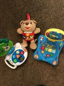 Selection of baby activity toys