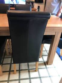 Solid oak extending dining table and 6 faux leather chairs