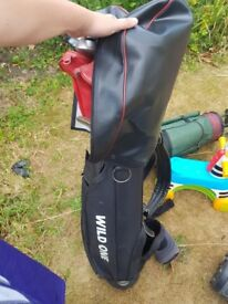 Golf clubs and wild one bag