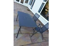 Glass table, 6 chairs and parasol patio set