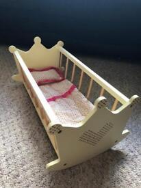 Dolls rocking crib includes bedding