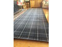 Brand new very long (4metres) grey tartan rug