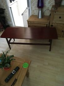 Retro coffee table ideal for someone who like the retro look good solid table