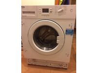 Integrated washing machine, new, unused.