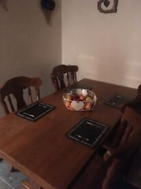 Dining table and 5 chairs solid oak and very heavy in good condition