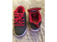 Red and grey sidewalk heelys