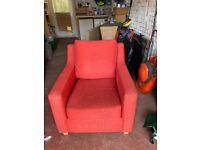Terracotta/ red armchair