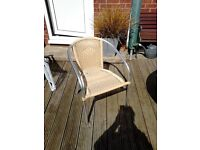 3 No Cane coloured ratan patio chairs with silver legs
