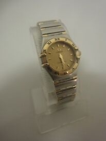 Ladies Omega Constellation steel and gold wrist watch on bracelet with original warrant card