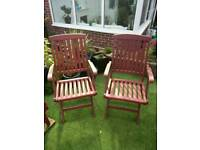 Two hardwood folding chairs and matching table