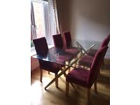 Glass dining table and chairs Vgc