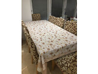 ***BEAUTIFUL WOODEN DINING TABLE SEATS 8 PERSONS INCLUDING MATCHING TABLE CLOTH AND CHAIR COVERS***