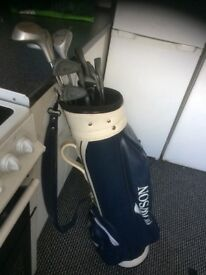 Golf clubs with bag tees and handful of balls