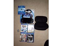 PLAYSTATION VITA, WIFI ENABLED WITH 5 GAMES AND CASE.