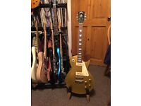 Vintage Gold Top Les Paul guitar.