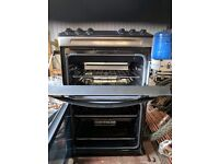 Brand new zanussi gas cooker 55cm , dint in left panel ,tested and all working