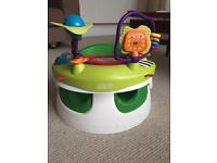 Mamas and Papas snug seat with tray and toy attachment