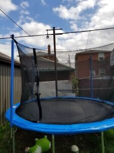 Blue and black Trampoline it's 14 ft new